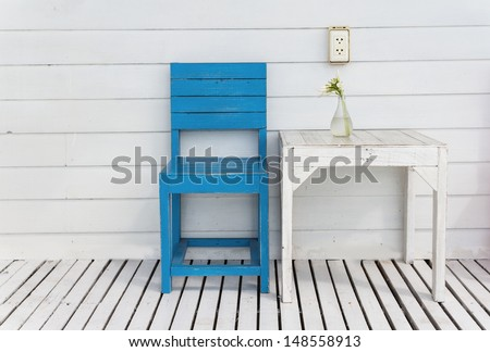 White table and blue wooden chair outdoor - stock photo