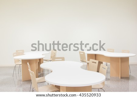 White table and wood chair in white room. - stock photo