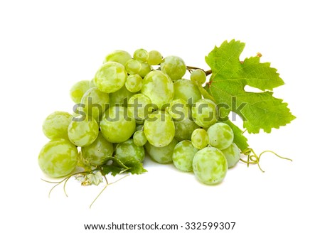 White table grapes with leaves on white background - stock photo