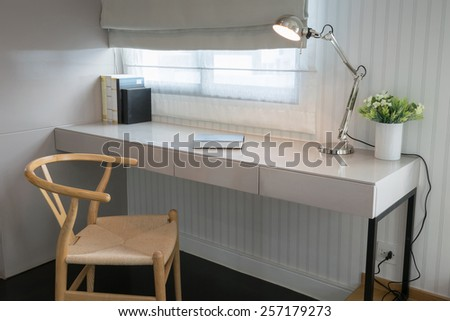 white table with wooden chair and books in modern working area at home - stock photo