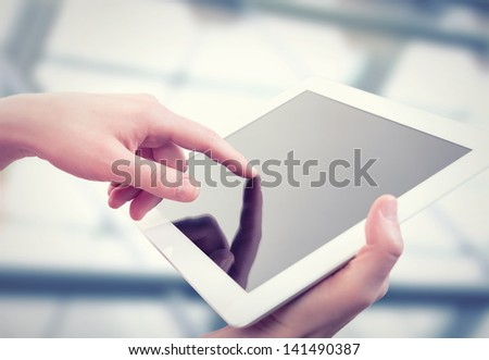 white tablet with a  blank empty screen in the hands - stock photo