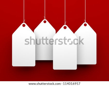 White tags on red background - stock photo