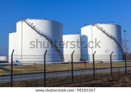 white tank in tank farm with blue sky - stock photo