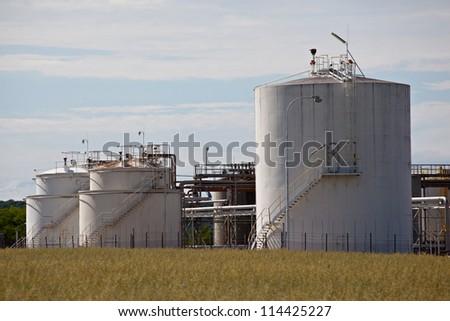 White tanks in oil refinery factory - stock photo