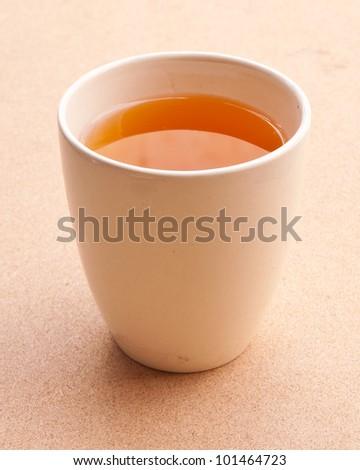 White tea cup on the floor. - stock photo