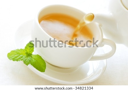 White Teapot and cup - stock photo