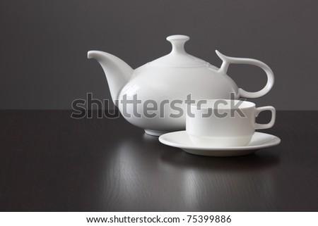 White teapot with a mug - stock photo