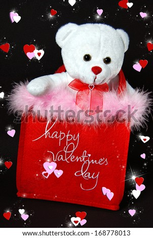 white teddy bear in valentine bag with hearts and sparkles - stock photo
