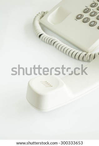 white telephone receiver in closeup - stock photo