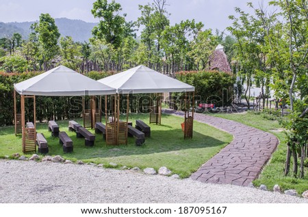 white tents set up in the garden with walkway - stock photo