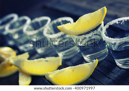 white tequila salt lemon wooden color - stock photo