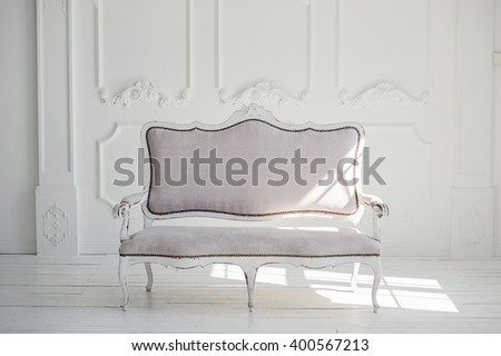 White textile classical style sofa in vintage room. White background. - stock photo