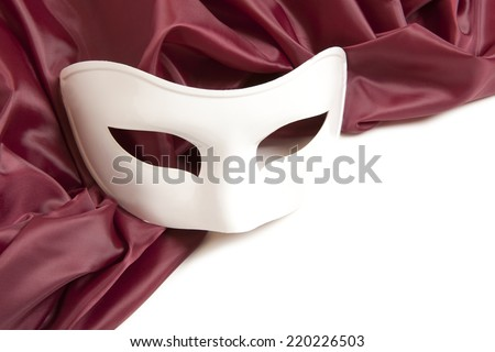 White theatrical mask and silk fabric isolated a white background - stock photo