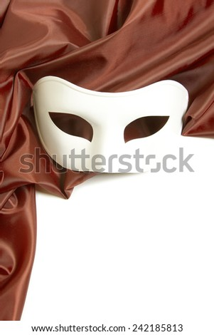 White theatrical mask and silk fabric on a white background  - stock photo