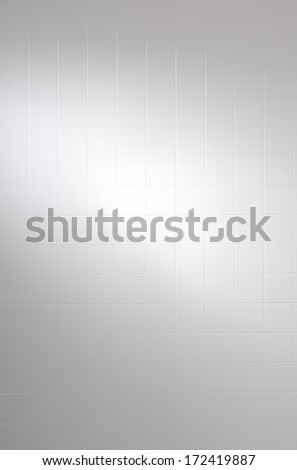 white tile wall - stock photo