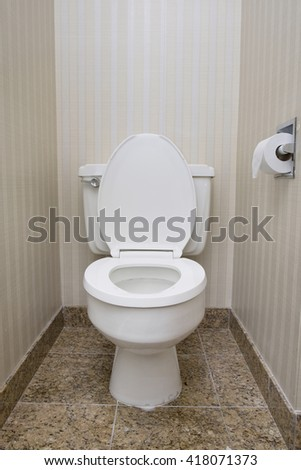 White toilet seat with tissue rolls - stock photo