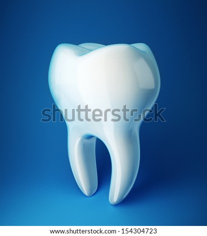 white tooth isolated on a blue background - stock photo