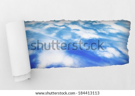 White Torn paper with sky extreme closeup - stock photo