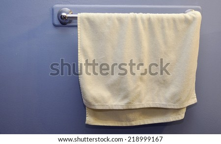 white towel hanging in washroom - stock photo