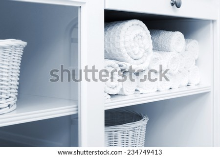 white towel on a shelf in the closet - stock photo