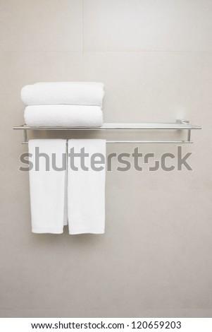 white towels prepared on hanger. - stock photo