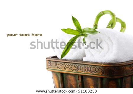 White towels with green bamboo with sample text - stock photo