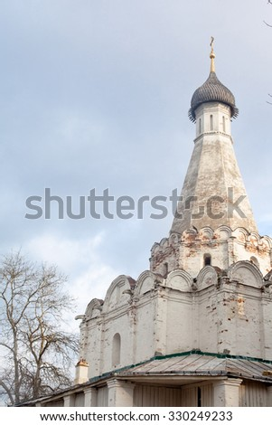 White tower with orthodox cross on the top