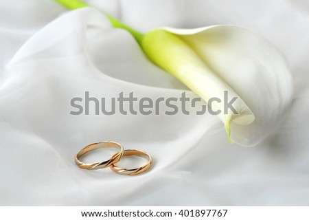 White transparent  fabric and wedding rings close up - stock photo