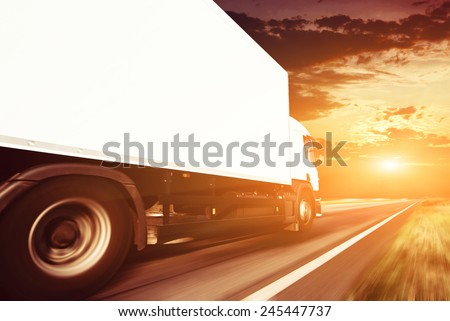White truck on the asphalt rural road - stock photo