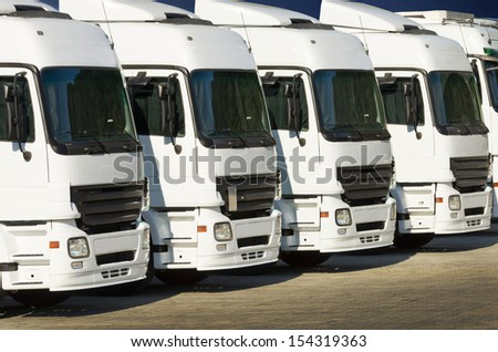 White trucks parked on a parking places - stock photo