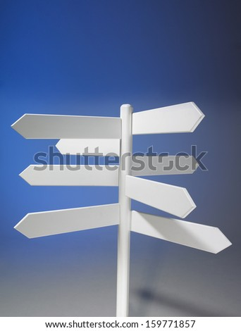 White unmarked signpost - stock photo