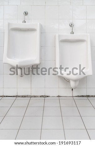 White urinals for men and boys in public toilet - stock photo