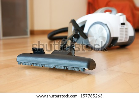White vacuum cleaner on  parquet. close-up - stock photo