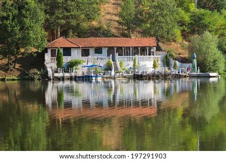white villa on the Ovcar Lake, Serbia - stock photo