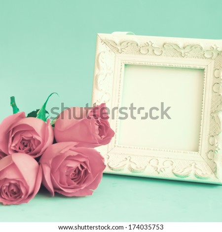White vintage frame and roses - stock photo