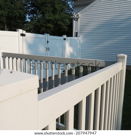White vinyl fences. - stock photo