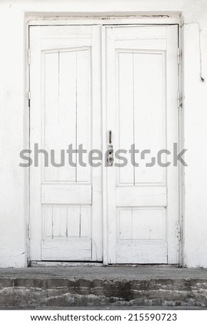 White wall and wooden door, background texture - stock photo