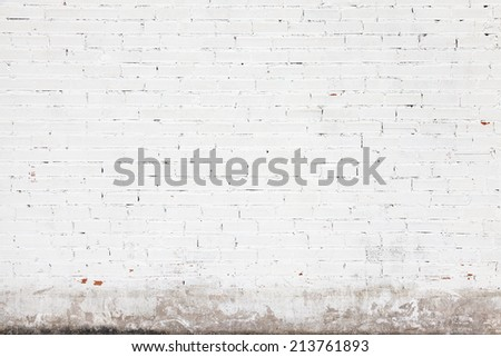 White wall background texture with bricks and cracks on stucco - stock photo