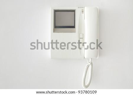 white wall intercom - stock photo