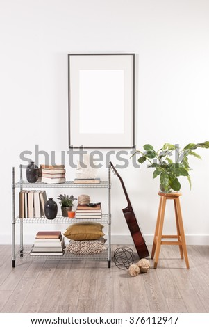 white wall office metal shelving guitar and stool with frame decoration - stock photo