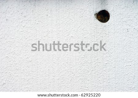 white wall with a hole background - stock photo