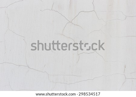 White wall with cracks for texture - stock photo