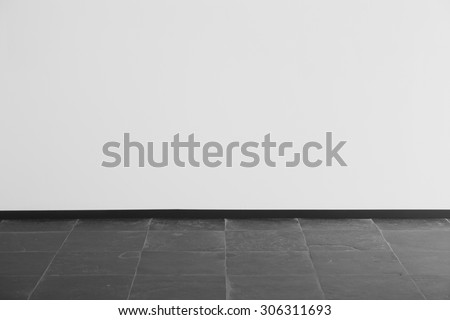 White wall with dark floor - stock photo