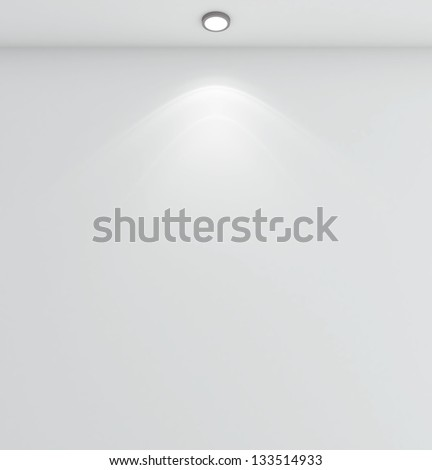 white wall with lamp on ceiling - stock photo