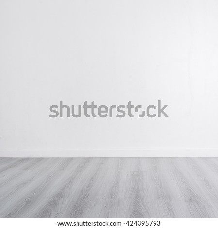 White wall with wooden gray floor and copyspace for your text, product display - stock photo