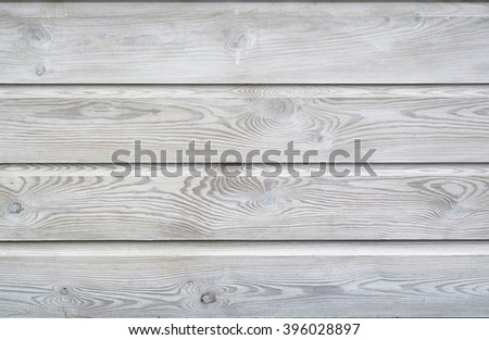 White wash painted texture wooden background of shelves planks with growth rings and wood grain vains - stock photo