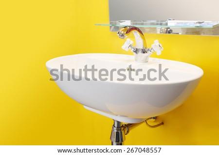 White washbasin isolated on white background - stock photo