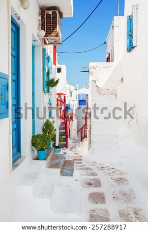 White washed street in Mykonos old town. Focus on foreground. Greece. - stock photo