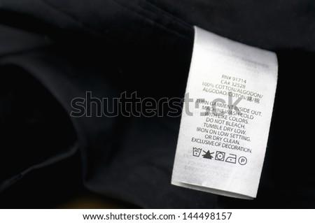 white washing instruction tag on black shirt - stock photo