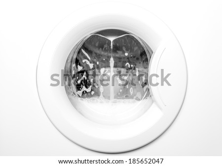 White washing machine with dirty clothes inside make foam - stock photo